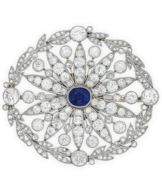 A BELLE EPOQUE SAPPHIRE AND DIAMOND BROOCH, CIRCA 1910. Designed as a pierced old and rose-cut diamond oval plaque of foliate motif, centering upon an oval-cut sapphire, 2 ins., mounted in platinum. #BelleÉpoque #brooch