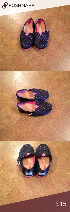 Black Toms Really cute black toms with shiny gold polka dots and pink soles. Only worn once. Comes from a clean, smoke free, pet free home. Toms Shoes Moccasins
