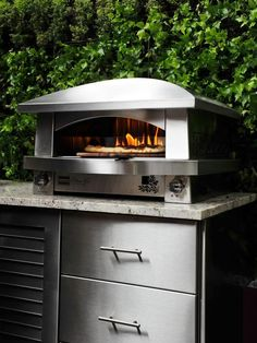 Pizza Ovens    For those who enjoy the smoky flavors of a delicious homemade pizza, a wood-fired pizza oven is the way to go. This amenity is usually a custom-built feature but do-it-yourself kits are available. Photo courtesy of Kalamazoo