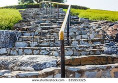 in Chiang Mai made on a round point is there this staircase with natural stone and in the middle of this banister - stock photo