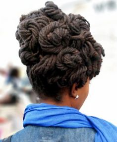 Small long locs in a twirly up-do. Would make a beautiful wedding hair style.