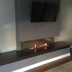 "Trisore 140 by Element4 - A three-sided or ""bay"" style fireplace, the Trisore 140 features a frameless built-in design with glass on three sides – for a fresh, modern look."
