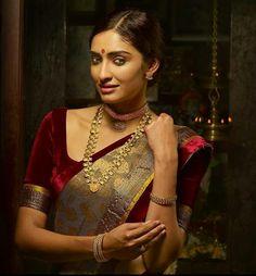 Burgundy velvet blouse with simple grey sari. Understated elegance.