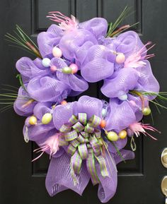 Love this Easter wreath, but I'd take that bow off the bottom; perhaps add a cross of wood or twigs.