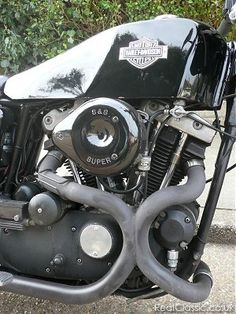 Willie G. Davidson designed the Harley-Davidson XLCR 1000 Café Racer as a personal project. The bike consists of an XR frame with a blacked out XL1000 engine. The bodywork is loosely based on the XR with a seat unit that tapers to the rear light and a coffin tank finished in black. While the XLCR did not sell well during its two years of production in 1977 and 1978, it served as a prototype for future Sportster models. The distinctive styling and limited production numbers have contri...