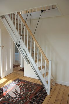 Midhurst (Expensive) Loft Ladder from the UK. Something like this would be ideal for accessing the attic space.