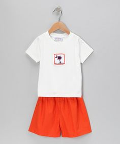 Embellished with a smocked appliqué, this well-constructed set is as perfect for pictures as it is for playing. Plus, the breezy shorts and a soft cotton tee create a comfy-as-a-cloud feel.