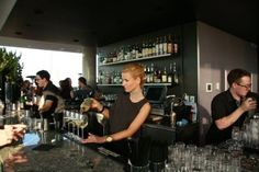 Bartender serves champagne at Thompson Toronto Rooftop, photo copyright Clarissa Magalhaes