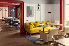 A bright yellow sofa injects a sense of fun into the scheme. Lounge Furniture, Bespoke Furniture, Architectural Digest, Munich, Bedroom Photography, Yellow Sofa, Off White Walls, Architrave, Banquette Seating