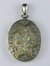 I like this Victorian Silver locket very much.....it looks like it belonged to a well to do lady.