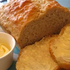Beer Bread:   Ingredients - 1 (12 fluid ounce) can or bottle beer, 3 cups self-rising flour, 2-3 tablespoons white sugar.  Directions - In a large bowl, mix sugar and flour.  Add beer, continue to mix.  Use wooden spoon at first then your hands.  Pour into 9x5in. greased loaf pan.  Bake at 350 for 50-60min.  Top will be crunchy, and the insides will be soft.  Serve topped with butter or cheese spread.