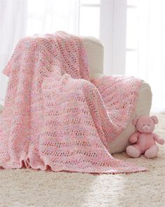 This sweet, cuddly #baby blanket is a great addition to any nursery. Shown in Bernat Dippity Dots. #knit