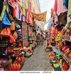 LOVE the colors and mix of culture in Granada!     Google Image Result for http://image.shutterstock.com/display_pic_with_logo/234100/234100,1266936865,6/stock-photo-street-market-in-granada-spain-47300743.jpg