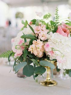 Colorful ranunculus, rose and eucalyptus wedding centerpieces: http://www.stylemepretty.com/little-black-book-blog/2016/09/28/chic-spring-texas-wedding/ Photography: Sarah Kate - http://sarahkatephoto.com/