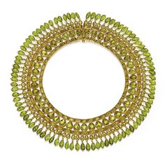 Gold and Peridot Necklace, set with rectangular-faceted and pear-shaped peridots, supporting a fringe composed of 86 drop-shaped briolettes from Sotheby's