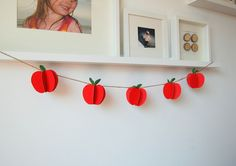 DIY apple garland by northstory blog...could be adapted for other holidays with different objects like pumpkins, snowflakes, etc.