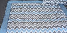 cool BabyFad Elephant Blue Chevron 9 Piece Baby Crib Bedding Set 0 0 This 9 piece crib bedding features a cute blue and grey Chevron fabric and adorable elephants that are embroidered into various pieces throughout the set; The zig zag fabric and solid fabrics in this set are all made from 100% natural cotton; These premium fabrics and modern design bring together a style perfect for a baby...