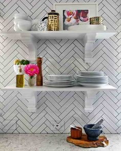 Organized and Open - The open shelving and decorative corbel shelf supports Kristin chose have a dual function: It is a stylish alternative to regular cabinets and shelving, and it offers easy access to ... anything and everything.