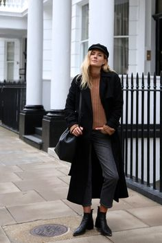 Lucy Williams wears a gorgeous black maxi coat with cropped denim jeans and a cute knitted pullover. Coat: Maje, Jumper: DEMYLEE, Jeans: Topshop, Boots: Acne.