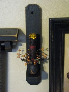 """Complete the primitive country look of your room with this 12"""" black wood sconce with a grungy drip burgundy timer candle from Primitive Star Quilt Shop. https://www.primitivestarquiltshop.com/collections/sconces-lighting/products/12-black-wood-sconce-grungy-drip-burgundy-timer-candle #primitivehomedecor"""