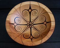"""The woodburned bowl is a custom order and is embellished with an abstract geometric design. The bowl is made of beech wood and is 7"""" in diameter."""
