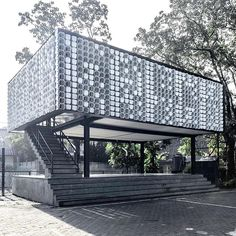 Microlibrary Bima by SHAU is our #ProjectOfTheDay/ This prototype pavilion is a first in a series of small libraries to be built throughout Indonesia/ Over a concrete and steel structure, empty ice cream buckets create an interesting façade for cross ventilation/ Explore this project on #Architizer . . . #recycledmaterials #indonesianarchitecture #bandung #prototype