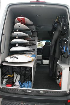 A place for everything the ultimate windsurf van.  If you have a big van then this solution is spot on - its just like a walk in wardrobe but full of neatly organised windsurf equipment! #windsurfvans #surfwagons #poolewindsurfing