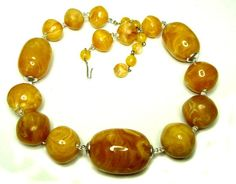"Swirled Butterscotch Bead Necklace - j128091 marked Hong Kong on the hook clasp.Plastic, resin beads in graduating sizes - large center bead is 40mm x 20mm.  16"" long. circa 1960's. Vintage costume jewelry. $48 - Free US shipping. Questions? PM me via FB. PayPal Only."