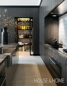 Pantries are attractive additions to potential homebuyers, so try turning a broom closet or nook into a bespoke pantry to showcase everyday essentials.   Photographer: Frans van der Heijden   Designer: Kate Hume and Frans van der Heijden