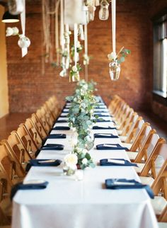 Long banquet tables with navy napkins