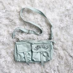 NOMVINTAGE // Seafoam Green Crossbody Purse Seafoam  green suede crossbody purse. Magnetic snap button closures for the pockets, ziplining at the opening and pocket on back. Nomvintage Bags Crossbody Bags