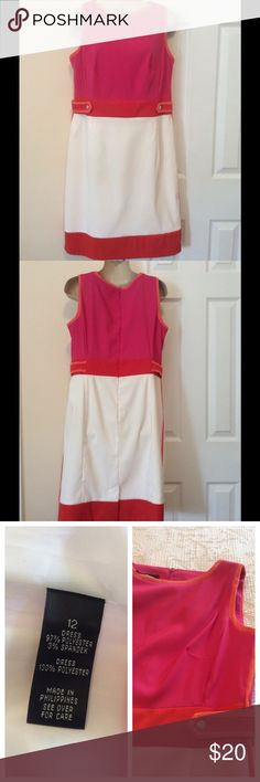 Color block dress Pink, orange and white lined dress.  Worn once.  I lost weight and it doesn't fit now.  Small slit in back for ease of movement.  Comes with free matching bracelet.  Measures 36 inches from back of neckline to hem.  Any two dresses from my closet will bundle at 25% discount rounded up to nearest dollar amount. AGB Dresses