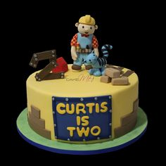 Bob the Builder cake, with all edible toppers made of fondant, including bricks, cat and tool box www.cakeme.com.au