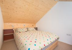 Upstairs bedroom in the end out house