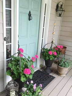 HGTV Gardens presents a slideshow of front doors in various colors with plants in containers and in beds.