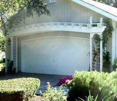 This Arched Garage Pergola looks amazing!