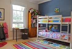 Fun bedroom mixes and matches various colors and patterns [Design: Luci.D Interiors]