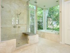 The master spa bath has crema marfil marble, with large double-head shower, soaking tub with a view of the private garden, separate lavatories, vanities and amazing closet.