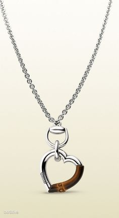 Gucci necklace with heart shaped charm with bamboo detail at Keswick Jewelers in Arlington Heights, IL, www.keswickjewelers.com