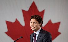 Liberal leader Justin Trudeau stands on stage at the Liberal party headquarters in Montreal, Tuesday, Oct. 20, 2015.