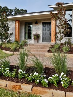 """""""Griege: Not as cool as gray, not a warm beige, this taupey color is perfect for those that want a non-white neutral. The color is beautiful in this Fixer Upper refresh of an brick ranch home."""" Pros and Cons: Painted Brick ExteriorsBECKI OWENS Café Exterior, House Paint Exterior, Exterior Remodel, Exterior House Colors, Exterior Design, Brick Exterior Makeover, Rustic Brick House Exterior, Stained Brick Exterior, White Wash Brick Exterior"""