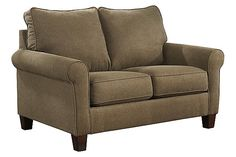 """The Zeth Twin Sofa Sleeper from Ashley Furniture HomeStore (AFHS.com). Not only is the """"Zeth-Basil"""" Sofa Sleeper collection a stylish contemporary sofa featuring shaped arms and supportive seating and back cushions surrounded by a rich toned upholstery fabric, but each sofa hides a comfortable sleeper that can instantly transform your living room into a guest room with the simple pull of the easy-lift mechanism."""