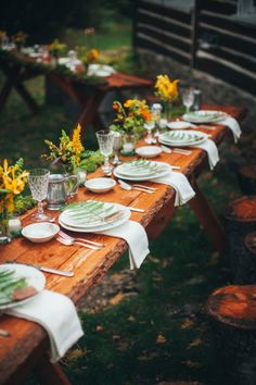 Foliage on place settings can add a charming aesthetic to a rustic tablescape. Bright blooms, meanwhile, keep the table from appearing too tired.  Via Junebug Weddings
