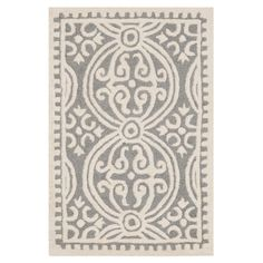 Showcasing a stylish medallion motif with scrolling accents, this beautifully hand-tufted wool rug adds an intriguing touch to your decor.  ...