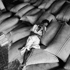 Cure for insomniacs. 200 bags per day to be lifted and brought into the warehouse and placed as shown.