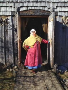 In Rosala viking village, Finland. Red kaftan made of hand woven and natural dyed wool.