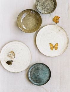 Ceramic plates and butterflies - what a perfect organic combination.