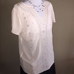 "White House Black Market Sheer Embroidered Top Bohemian undertones. Perfect for Spring and Summer! Blush Pink sheer top with beautiful silver embroidery and notched v-neckline. Perfect for layering with a cami or bralette. Relaxed fit with mostly straight cut on sides. 100% Polyester. Care Instructions:  Hand wash. Length is approximately 27"" from shoulder. Also have size 8 available in separate listing. WHBM Gray Stone Open Cuff Bracelet available in my closet would accessorize this top…"