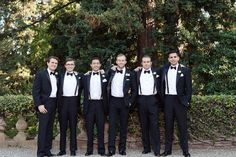 Groom and groomsmen, handsome in classic Ralph Lauren tuxes.