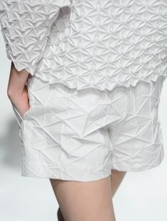 Fabric Manipulation - pleated shorts & top with geometric patterns + texture; fashion detail // Issey Miyake Spring 2015